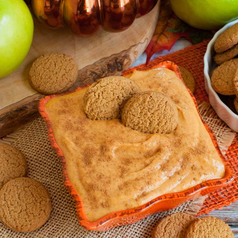 ginger snap cookies in an orange bowl of pumpkin dip