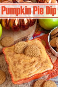 ginger snap cookies in a bowl of pumpkin dip