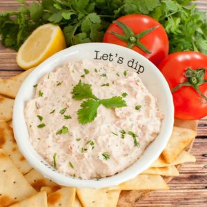 white bowl filled with texas love dip that reads let's dip