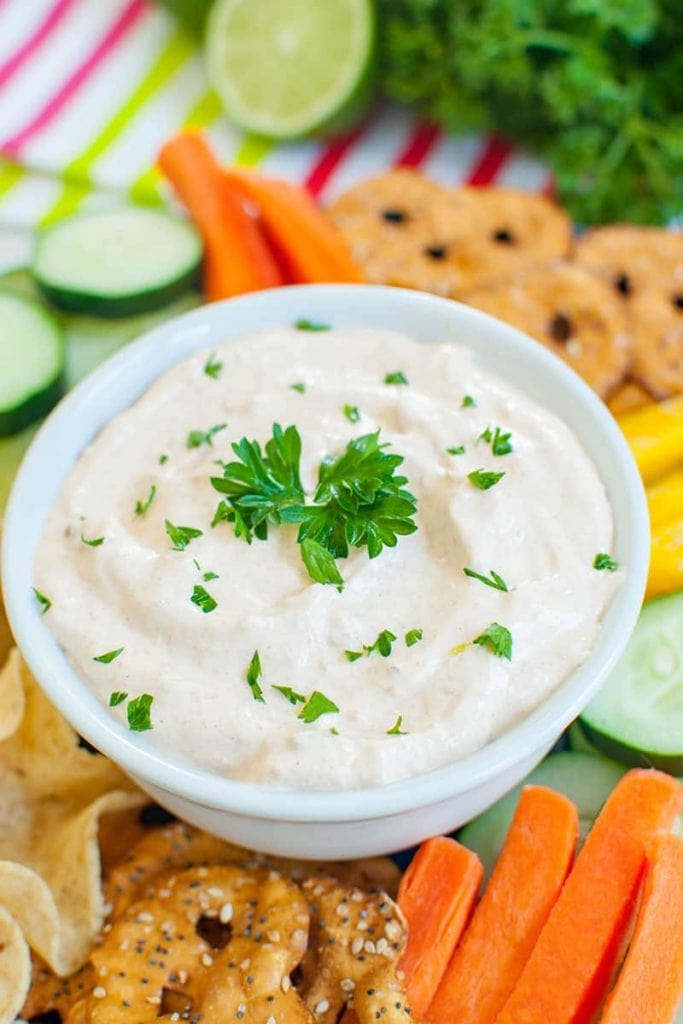 veggies and a white bowl of chipotle mayonnaise dip