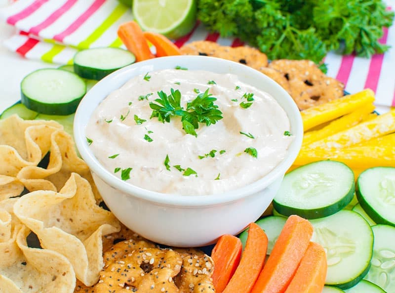 chipotle dip in a white bowl with veggies