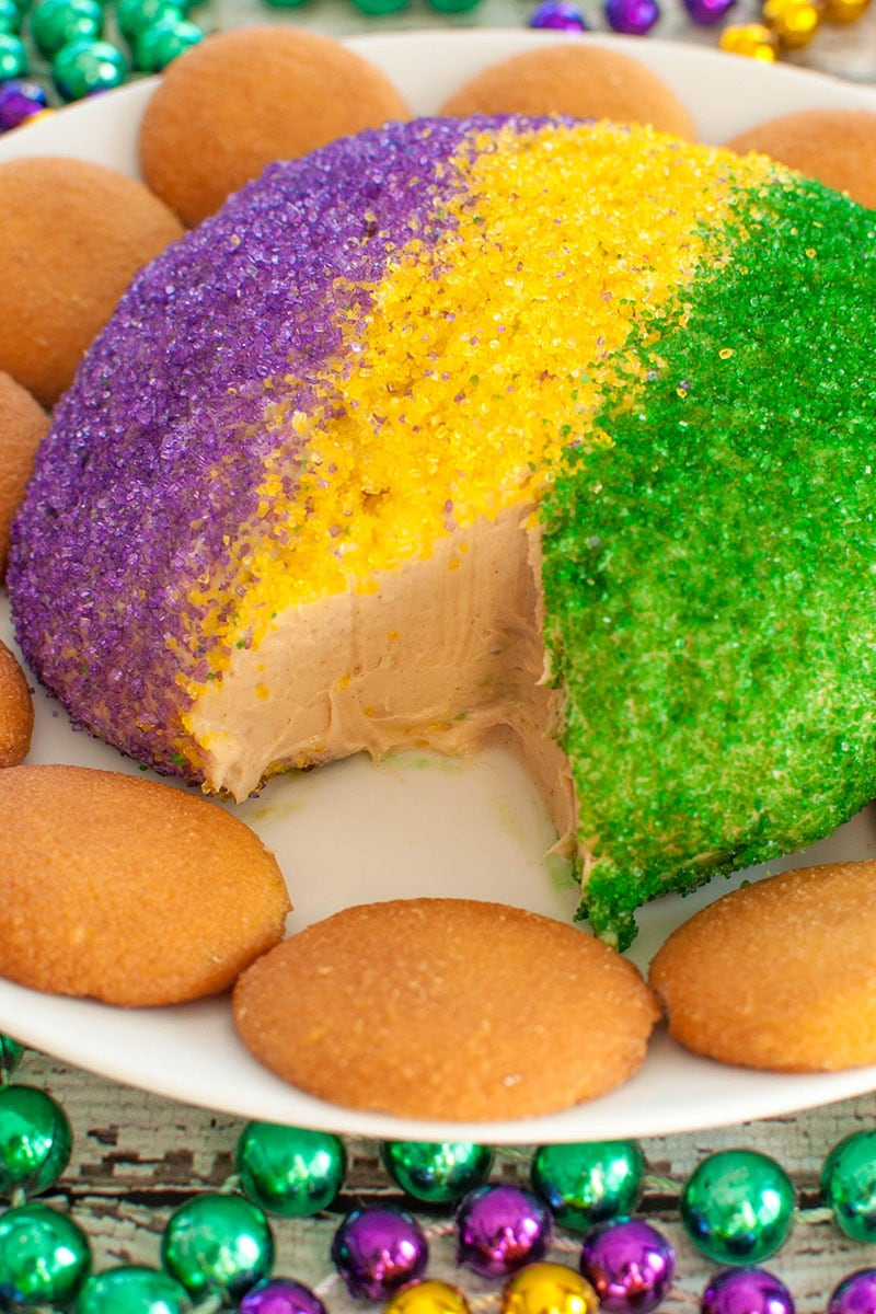 slice cut out of king cake cheese ball