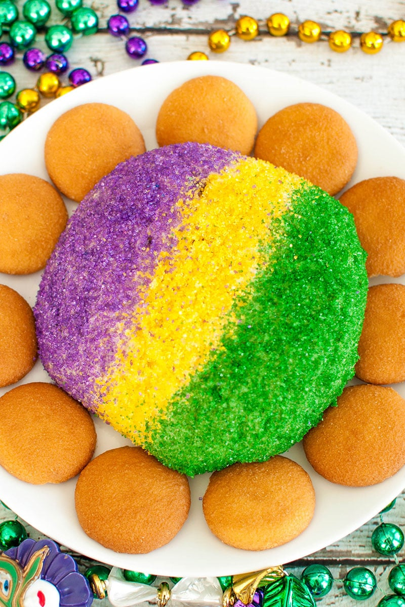 purple, gold and green cheese ball on white plate with vanilla wafers