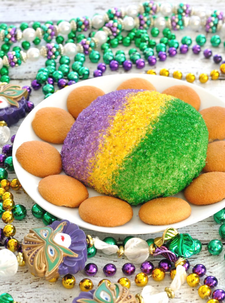 Festive King Cake Cheese Ball has the flavor and colors of a King Cake, but in an easy to make cheese ball. Great dessert to celebrate Mardi Gras!