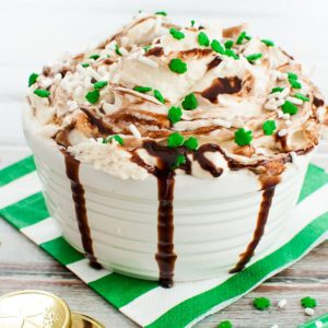 Bowl of Baileys Irish Cream Dip drizzled with chocolate and topped with festive sprinkles
