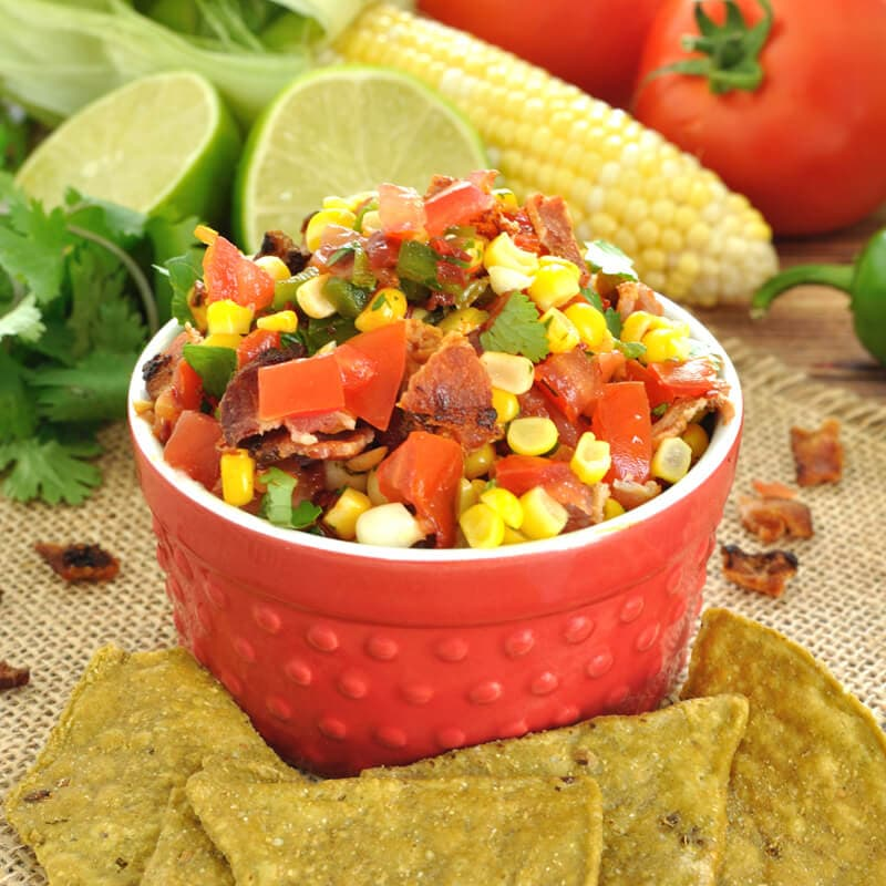 Fresh summer salsa gets a kick with the addition of chipotle peppers and a nice crunch from crumbled bacon in this chipotle bacon and corn salsa recipe.