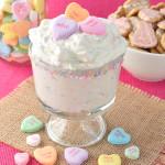 Classic Valentine's Day conversation hearts add a fun twist to this Conversation Heart Cheesecake Dip recipe. Easy Valentine's day dessert idea.