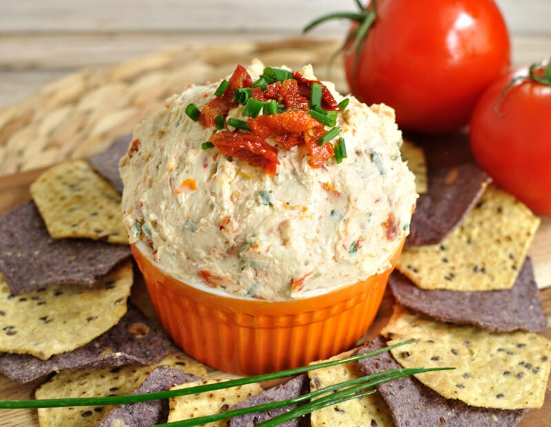 orange bowl with sun-dried tomato dip