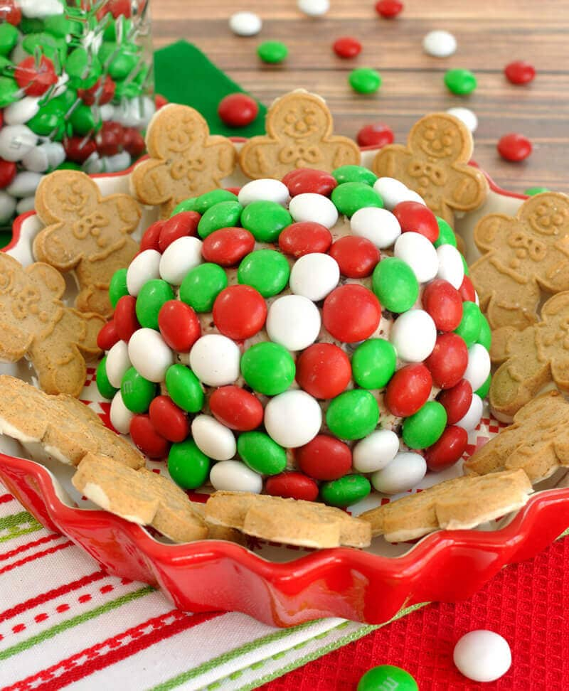 A minty, fun and festive dessert dip for the holidays. This easy Holiday M&M Peppermint Cheese Ball will have your party guests coming back for more.