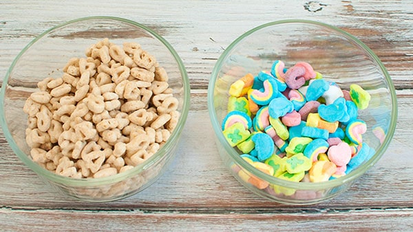 2 bowls side by side with separated lucky charms cereal and lucky charms marshmallows