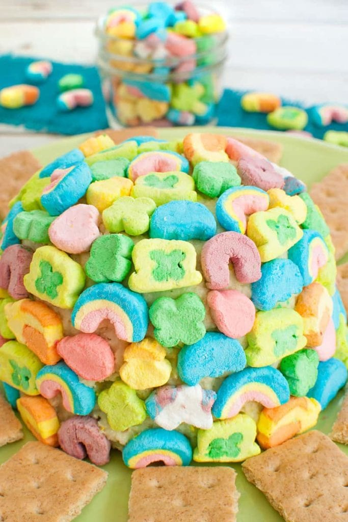Lucky Charms Cheesecake cheese ball covered in lucky charm marshmallows