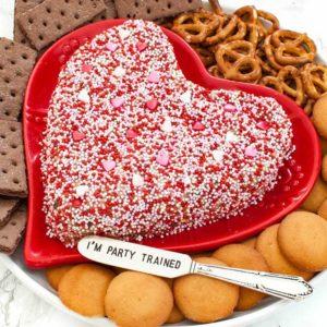 heart dessert peanut butter cheese ball on a red heart shaped platter