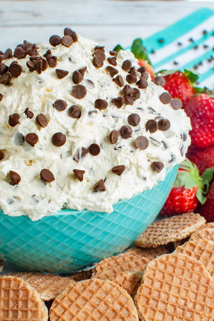 dip in teal bowl with strawberries and cookies
