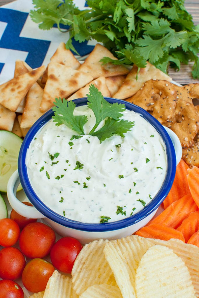 platter of dippers with a blue and white bowl of garlic dip