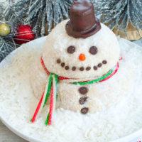 snowman cheese ball on white platter