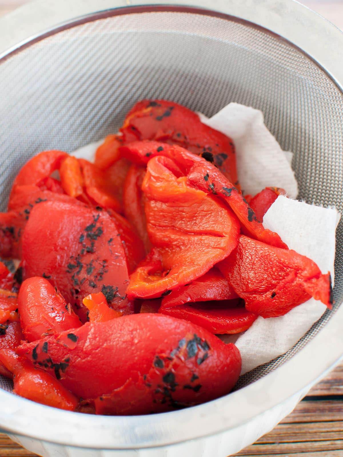 red peppers in strainer