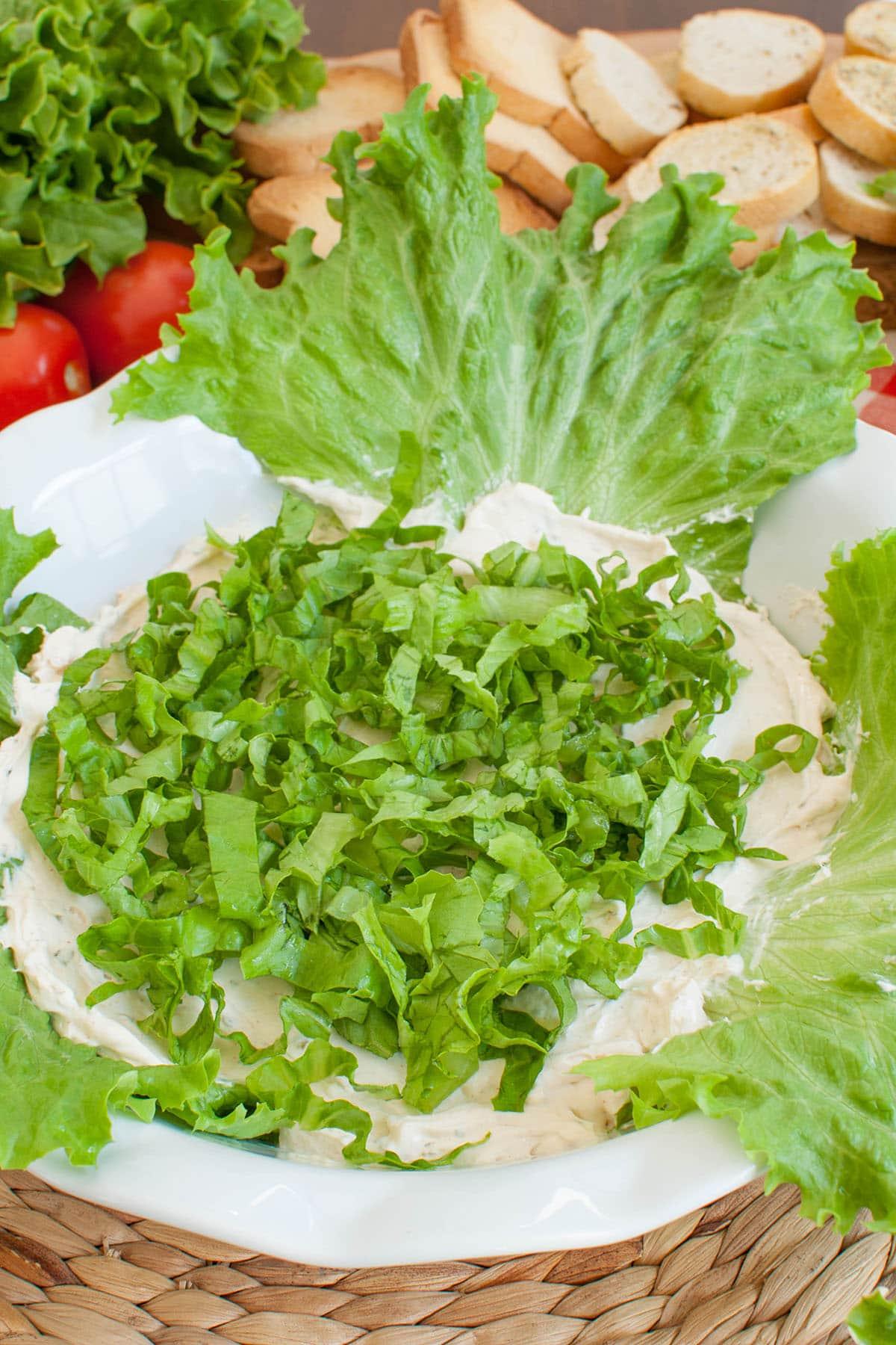 shredded lettuce added to dish